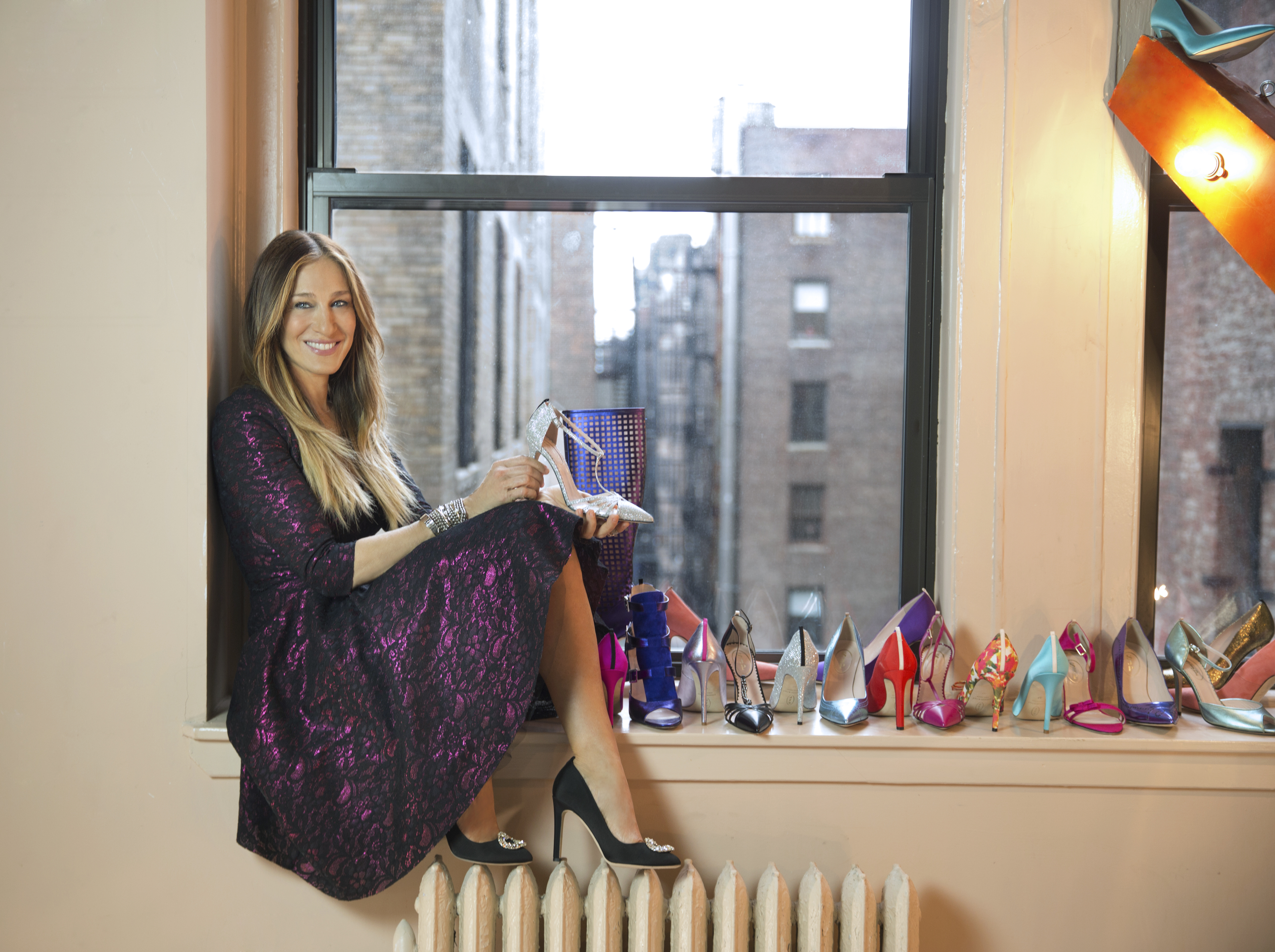 Sarah Jessica Parket surrounded by SJP by Sarah Jessica Parker shoes.