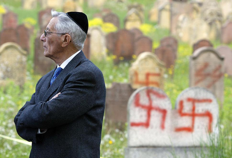 A member of the Jewish community is seen 02 May 2004, at the cemetery near the town of Colmar, close to the German border, after more than 100 graves were daubed with anti-Semitic slogans 30 April. The desecration of headstones in Vandalism at a Jewish cemetery in eastern France has highlighted problems in combating a sharp rise in anti-Semitic incidents in Europe.  AFP PHOTO/FREDERICK FLORIN   (Photo credit should read FREDERICK FLORIN/AFP/Getty Images)