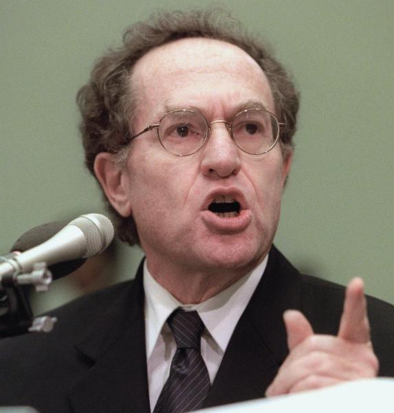 Harvard Law Professor Alan Dershowitz, pictured here defending President Clinton at impeachment hearings on Capitol Hill in Washington, has devoted his career to defending the accused. Suddenly he found himself accused of a preposterous and false charge. (LUKE FRAZZA/AFP/Getty Images)