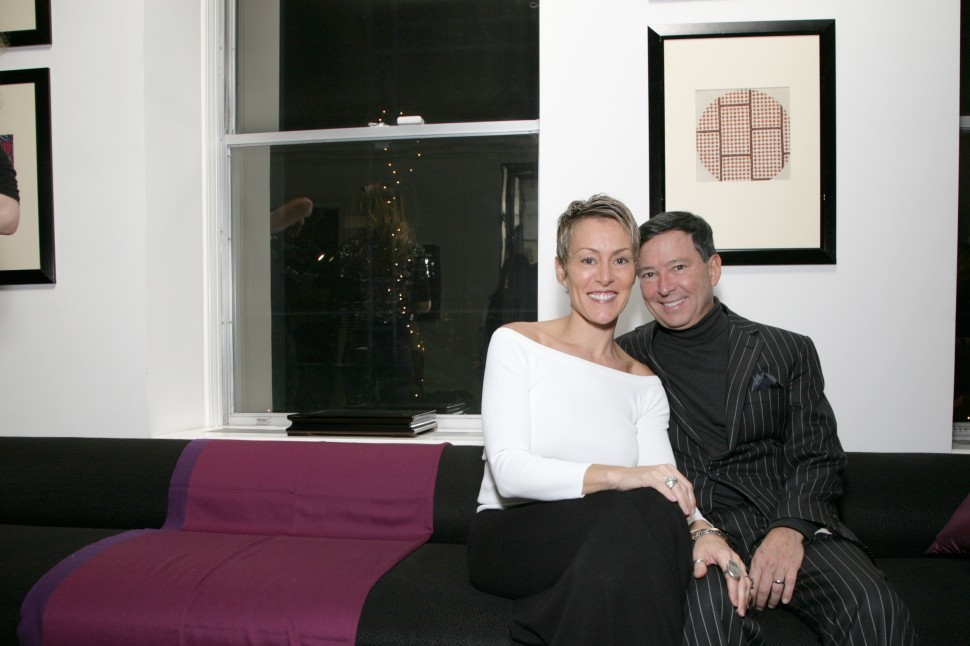 Niko Elmaleh with his wife Bethany Elmaleh on his lap at a Learning Leaders private event in New York City, December 08, 2010 (RICHARD KOEK/PatrickMcMullan.com)