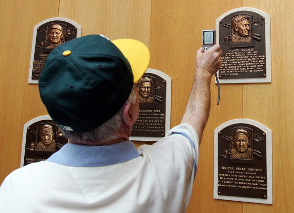 The plaque of Honus Wagner is photographed by a fan at the National Baseball Hall of Fame and Museum during the Baseball Hall of Fame weekend in 2008 in Cooperstown, New York.  (Photo by Jim McIsaac/Getty Images)