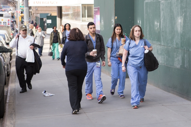 Hospital staff walking to work outside of NYU Langone Medical Center (Arman Dzidzovic/New York Observer)