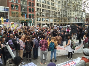 Protesters at Union Square listening to a musician on stage (Ben Shapiro/Observer)