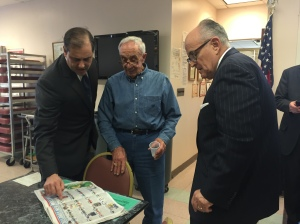State Sen. Andrew Lanza and Mayor Rudolph Giuliani check out a mock NFL draft with a senior. (Photo: Jillian Jorgensen/New York Observer)