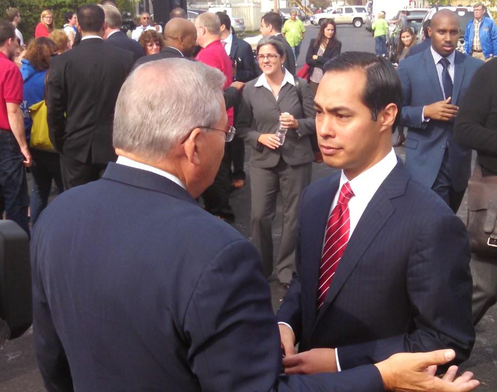 Menendez, left, last year with Julian Castro.