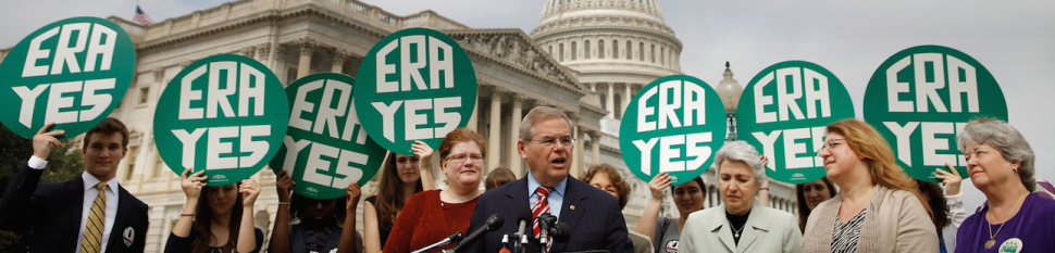 MARCH 22: U.S. Sen. Robert Menendez (D-NJ) (C) and representatives of women's groups hold a rally to mark the 40th anniversary of congressional passage of the Equal Rights Amendment (ERA) outside the U.S. Capitol March 22, 2012 in Washington, DC. Menendez and U.S. Rep. Carolyn Maloney (D-NY) introduced a new version of the Equal Rights Amendment last year and called for it to be passed again. (Photo by Chip Somodevilla/Getty Images)