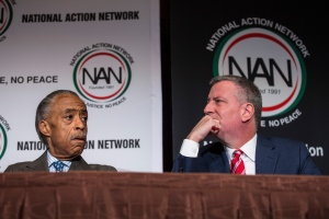 Rev. Al Sharpton and Mayor Bill de Blasio today at the National Action Network convention, where they discussed police body cameras. (Photo by Andrew Burton/Getty Images)
