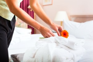 A new maid boot camp will teach you how to fluff that pillow properly before placing the flower on it. (Shutterstock)