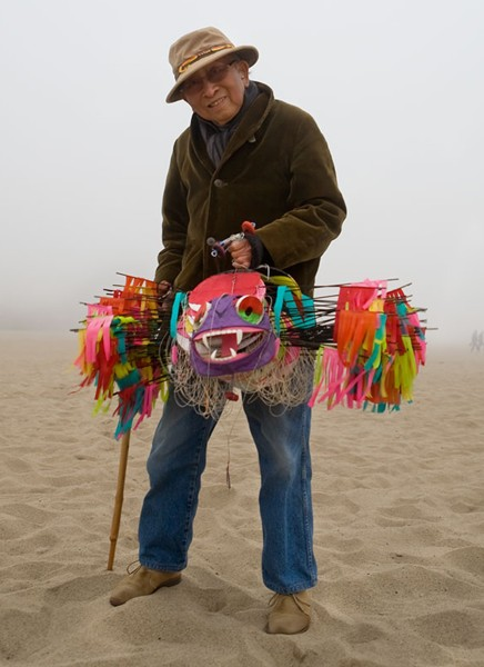 Tyrus Wong flying one of his kites in Santa Monica Beach. The artist is 104-years-old. (Photograph by Sarah Jane)