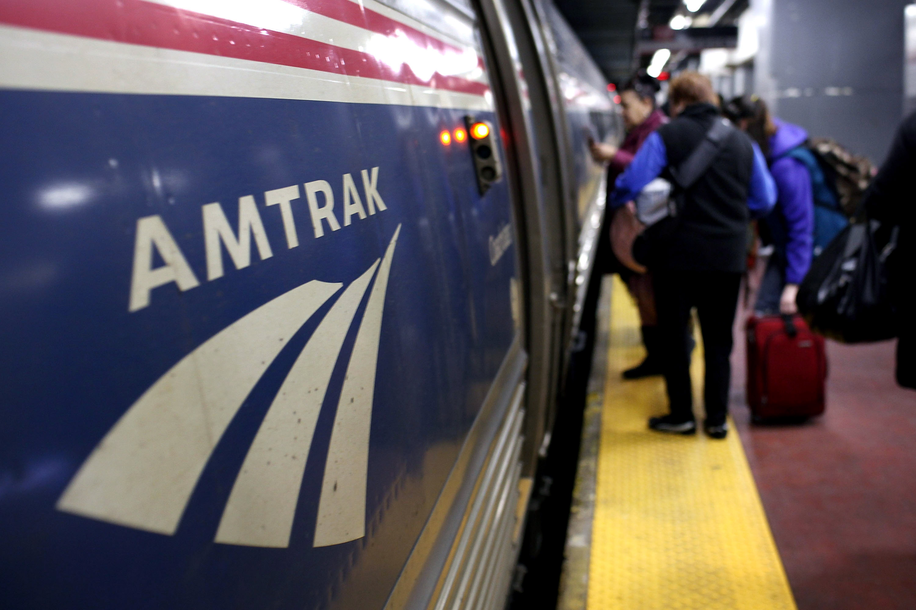 People board an Amtrak train at Penn Station on February 8, 2011 in New York City.  (Photo by Spencer Platt/Getty Images)