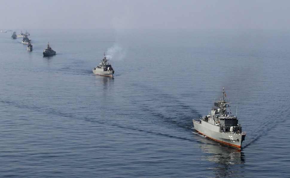 "Iranian Navy boats take part in maneuvers during the ""Velayat-90"" navy exercises in the Strait of Hormuz in southern Iran on January 3, 2012. (Photo: EBRAHIM NOROOZI/AFP/Getty Images)"