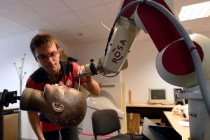 An engineer checks a robot used by neurosurgeons. BORIS HORVAT/AFP/Getty Images)