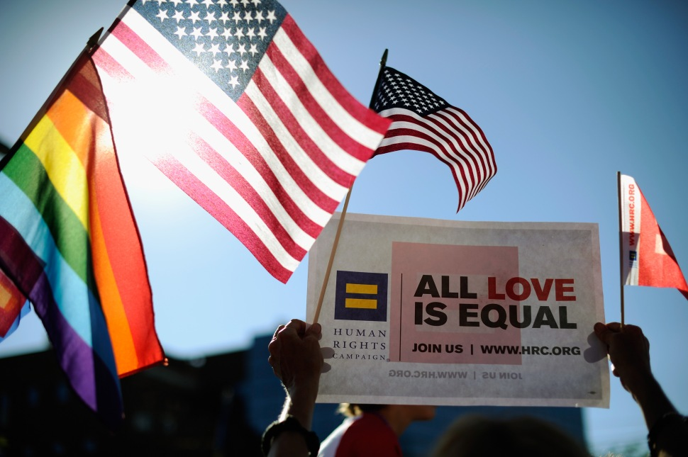 Same-sex marriage supporters celebrate the US Supreme Court ruling during a community rally on June 26, 2013 in West Hollywood, California.   (Photo: Kevork Djansezian/Getty Images)