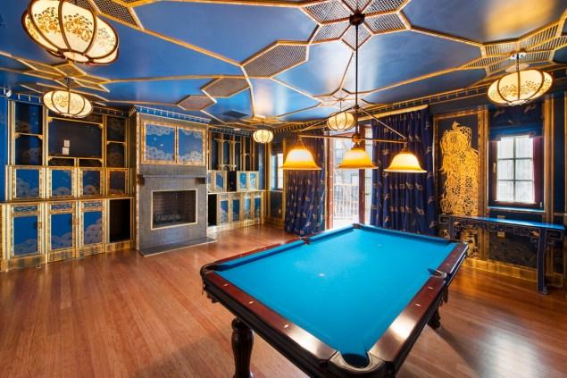 An Asian motif runs through the billiard room.