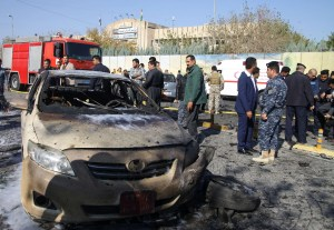 Iraqi security forces stand at the site where a suicide bomber detonated an explosives-rigged vehicle in the Iraqi Kurdish regional capital Arbil on November 19, 2014, killing four people.      (Photo: AFP/Getty Images)