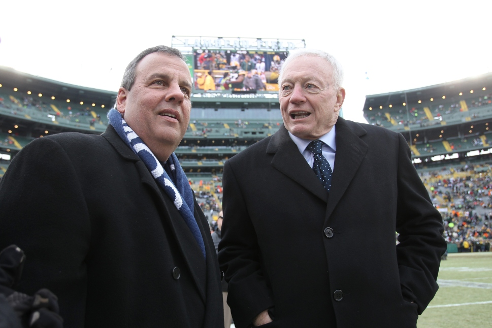 GREEN BAY, WI - JANUARY 11:  New Jersey Governor Chris Christie and Dallas Cowboys owner Jerry Jones talk prior to the 2015 NFC Divisional Playoff game between the Dallas Cowboys and the Green Bay Packers at Lambeau Field on January 11, 2015 in Green Bay, Wisconsin.  (Photo by Mike McGinnis/Getty Images)