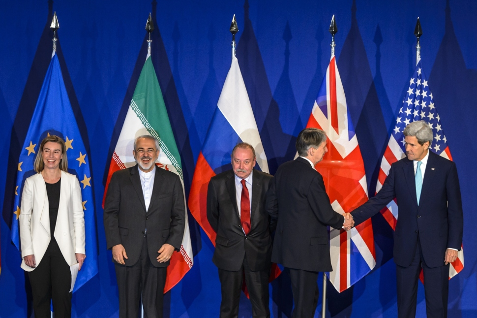 """(From L) EU's foreign policy chief Federica Mogherini, Iranian Foreign Minister Mohammad Javad Zarif, Deputy director of the Department for Nonproliferation and Arms Control of the Ministry of Foreign Affairs of Russia Alexey Karpov, British Foreign Secretary Philip Hammond and US Secretary of State John Kerry attend the announcement of an agreement on Iran nuclear talks on April 2, 2015 at the The Swiss Federal Institutes of Technology (EPFL) in Lausanne. Iran and world powers said they had reached agreement on Thursday on """"key parameters"""" of a potentially historic deal aimed at preventing Tehran from building the bomb. AFP PHOTO / FABRICE COFFRINI        (Photo credit should read FABRICE COFFRINI/AFP/Getty Images)"""