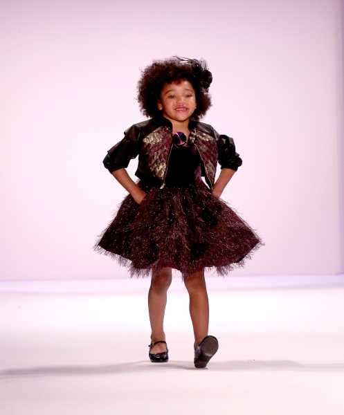 Stylish tots walked the runway, too. (Photo: Getty)