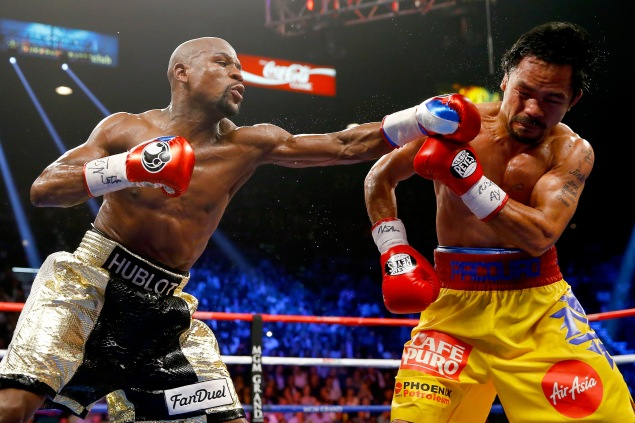 Floyd Mayweather Jr. throws a left at Manny Pacquiao (Photo: Al Bello/Getty Images).