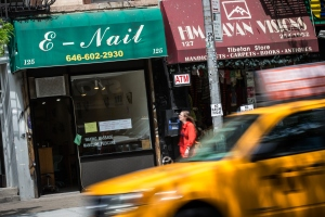 NEW YORK, NY - MAY 11:  A sign for a nail salon is seen on May 11, 2015 in the East Village neighborhood of New York City. New York Governor Andrew Cuomo announced emergency measures to protect nail salon workers after an investigative report by the New York Times revealed many workers are exploited and under paid.  (Photo by Andrew Burton/Getty Images)