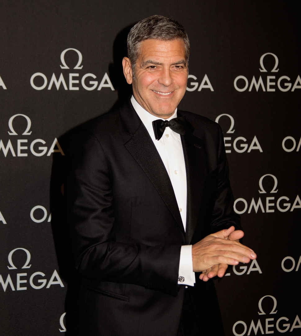 George Clooney arrives at the event. (Photo: Getty)