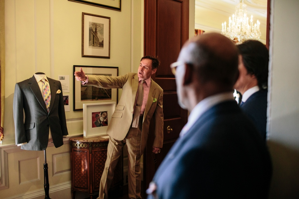WASHINGTON, DC - MAY 14:  Nick Foulkes, (L) curator of the exhibition, gives a tour to attendees at Savile Row Bespoke and America at the British Ambassador's Residence on May 14, 2015 in Washington, DC.  (Photo by Greg Kahn/Getty Images for The British Embassy)