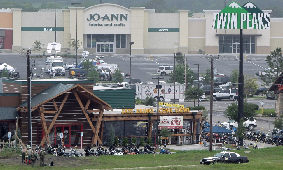 WACO, TX - MAY 18:  Motorcyles sit in the parking lot of the Twin Peaks restaurant, the scene of a motorcyle gang shootout that led to nine dead, many injured and 170 arrested. (Erich Schlegel/Getty Images)