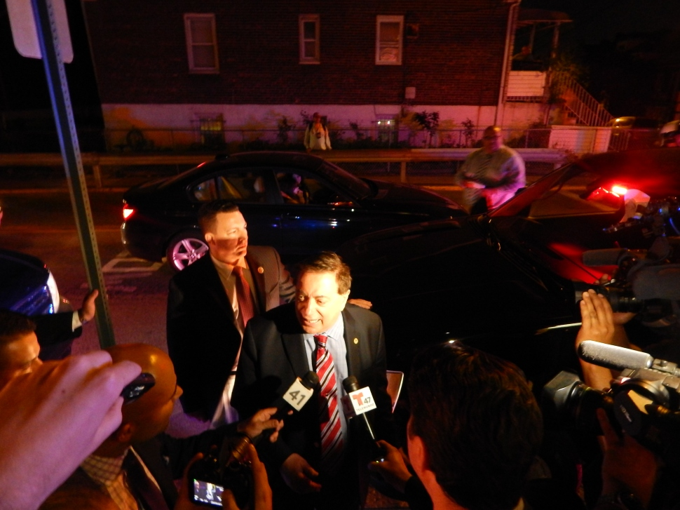 Sacco speaks with reporters outside 90 Palisades.