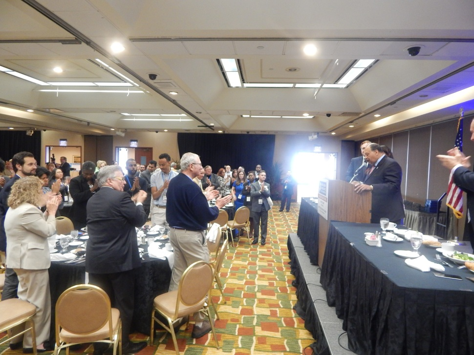 Currie gets a standing ovation at Friday's luncheon.