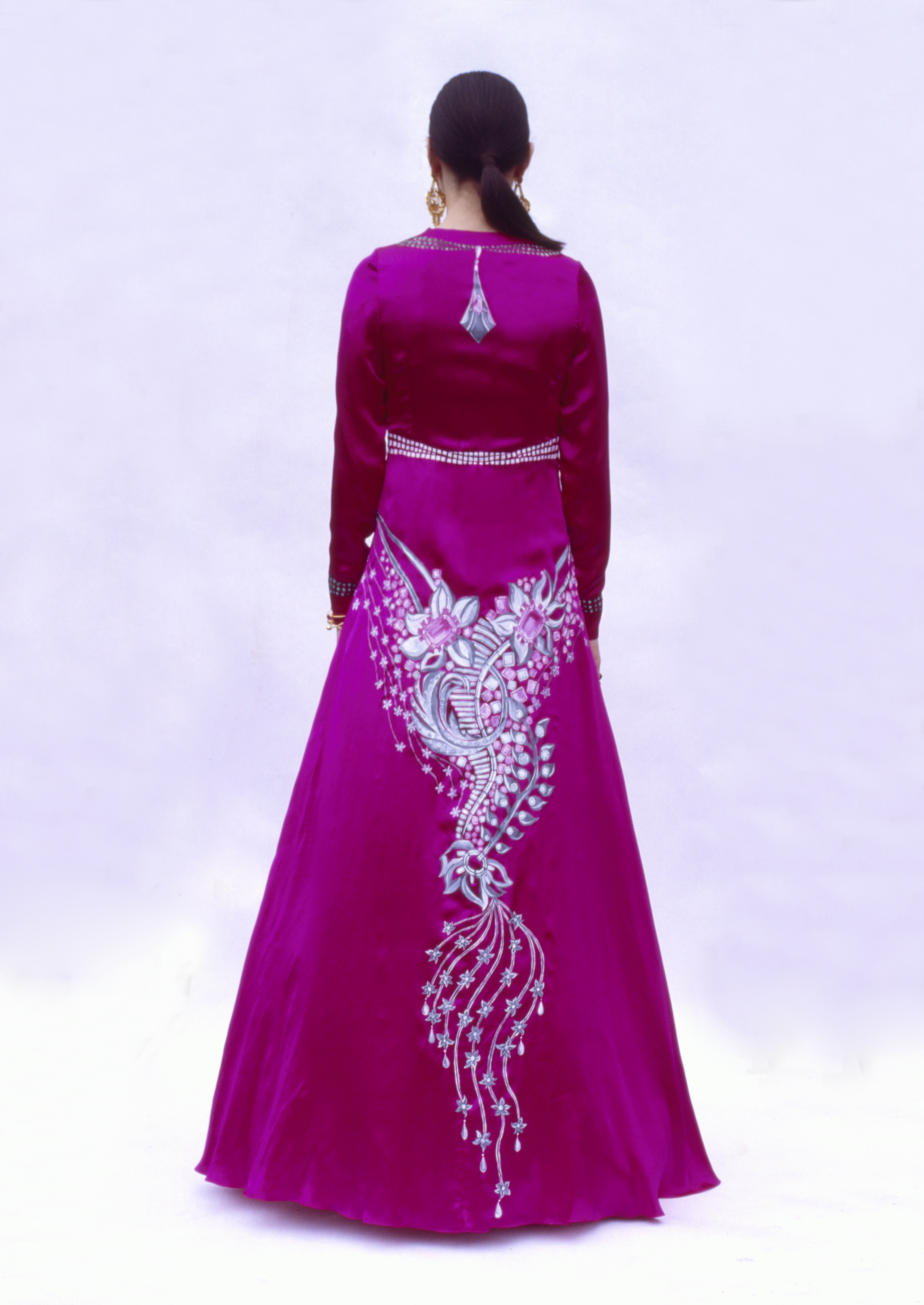 The back of a fuchsia gown