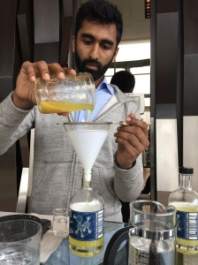 Ronak Parikh filtering fresh limoncello (The New York Observer/Sage Lazzaro)