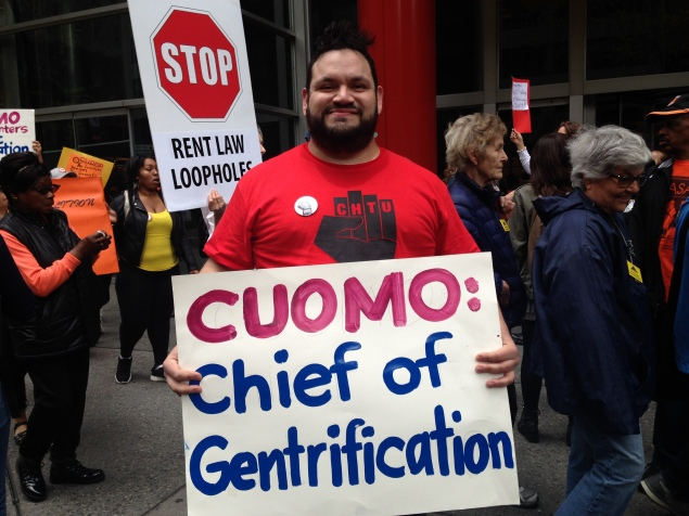 Crown Heights Tenants Union organizer Esteban Giron protests outside Gov. Andrew Cuomo's office  (Photo: Will Bredderman/New York Observer).