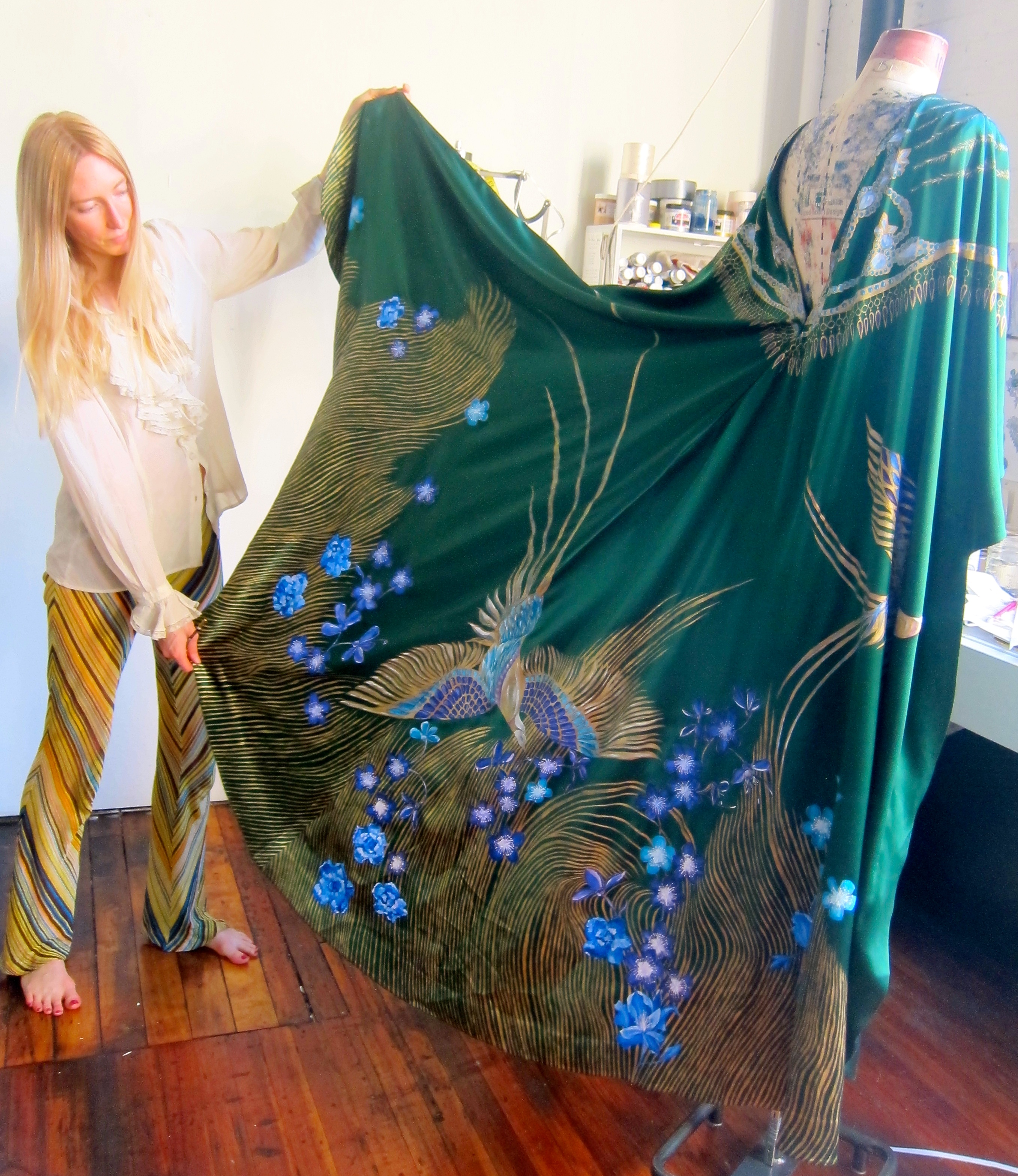 Holly Fowler shows off the hand-painted details of the dress worn by Samantha Boardman to the Met Gala