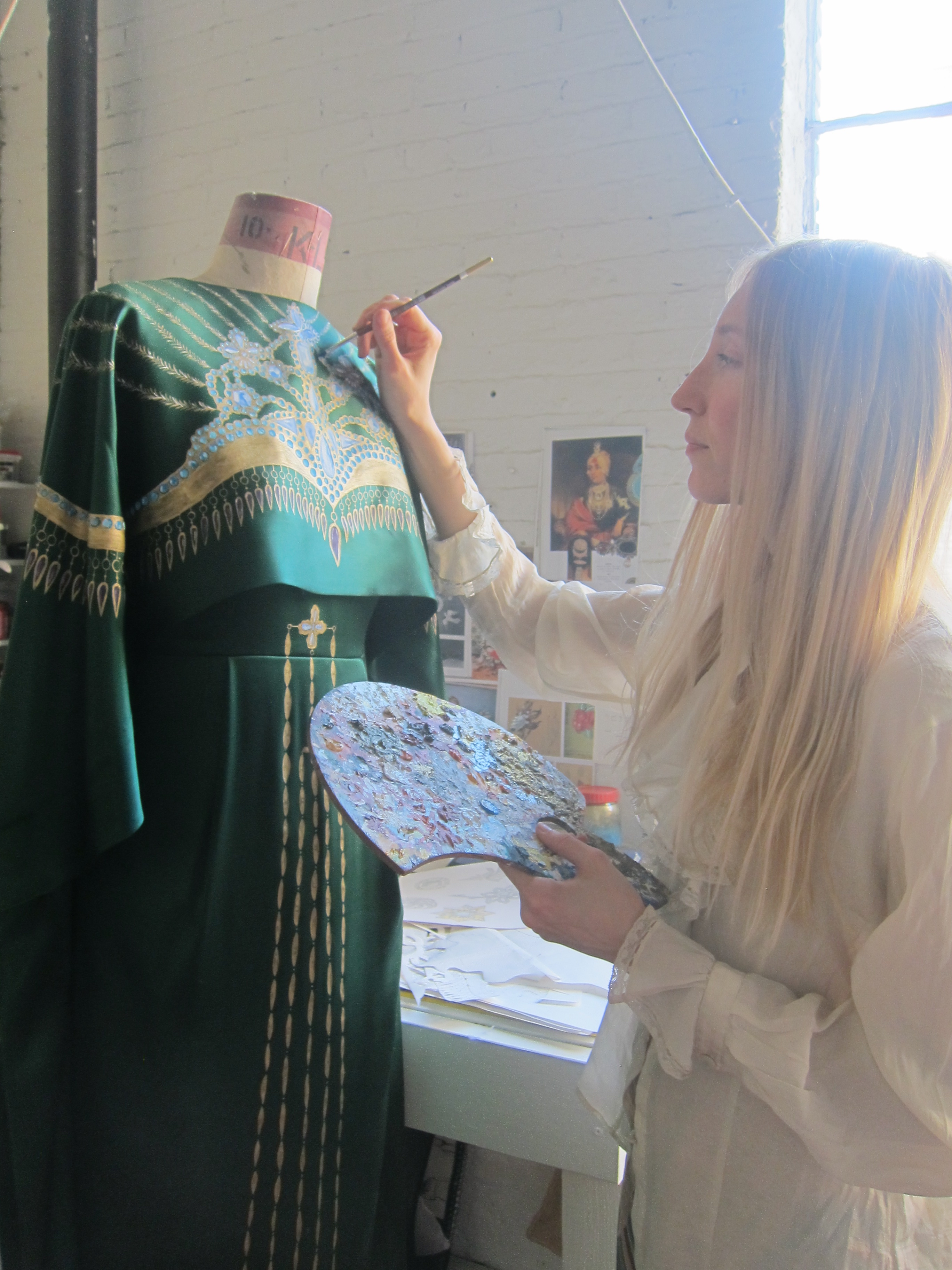 Holly Fowler painting a Chinese-inspired gown for the Met Gala