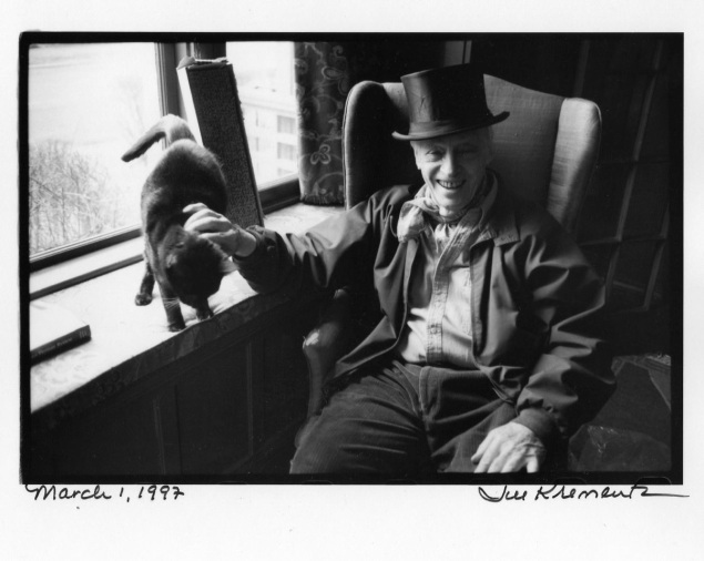 """CAT AND A HAT:  Bellow, winner of the 1976 Nobel Prize in literature, is wearing the top hat he wore to accept his honor in Stockholm.  Bellow described his companion as """"Moose, a fine black tom with a white throat who looks like a maitre d'hotel.  He shares my bed daily.  My siesta lasts for an hor.  He sleeps some twenty hours a day."""" One a castoff kitten discovered clinging to a screen door, Mose is now seven years old."""""""