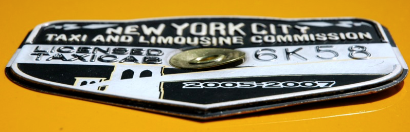 Medallion attached on the hood of a taxicab