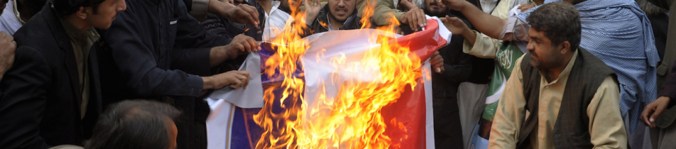 Pakistani demonstrators burn a French flag during a protest against the printing of satirical sketches of the Prophet Muhammad by French magazine Charlie Hebdo in Quetta on January 16, 2014. (Photo: BANARAS KHAN/AFP/Getty Images)