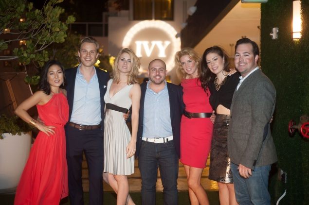 Ivy cofounders Philipp Tribel (second from left) and Beri Meric (middle) with the Ivy team at Art Basel. (Photo: Ivy/For New York Observer)