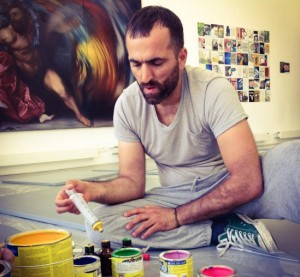 Artist Khaled Jarrar prepares the paint cans for his performance and the opening of his show. (Photo Courtesy Art Bärtschi & Cie via Facebook)