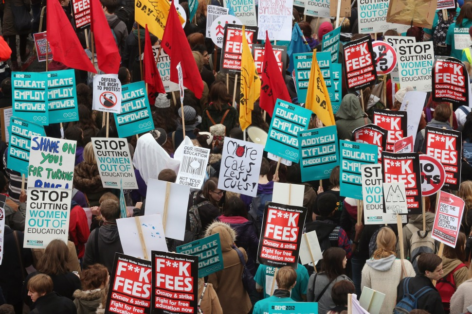 LONDON, ENGLAND - NOVEMBER 21:  Students march through Westminster as they protest against the rising costs of further education on November 21, 2012 in London, England. The demonstration march was organised by  the National Union of Students and is the first national student protest since a series of violent protests against tuition fees two years ago.  (Photo by Oli Scarff/Getty Images)