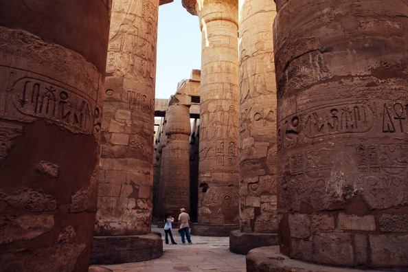 couple of tourists walk through the Karnak Temple in 2013 in Luxor, Egypt. (Photo: Ed Giles/Getty Images)