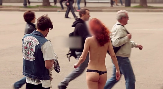 Gregory paid this young lady to walk across the public square wearing only her underwear. (screenshot)