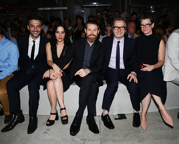 MILAN, ITALY - JUNE 21:  Filippo Timi, Giada Colagrande, Willem Dafoe, Gary Oldman and Gisele Schmidt attend the Prada show during the Milan Men's Fashion Week Spring/Summer 2016 on June 21, 2015 in Milan, Italy.  (Photo by Vittorio Zunino Celotto/Getty Images for Prada)