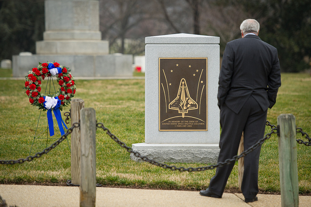Former NASA Administrator Sean O'Keefe pays his respects at the Space Shuttle Columbia Memorial after attending a wreath laying ceremony that was part of NASA's Day of Remembrance, Thursday, Jan. 26, 2012, at Arlington National Cemetery. Wreathes were laid in memory of those men and women who lost their lives in the quest for space exploration. Photo Credit: (NASA/Bill Ingalls)