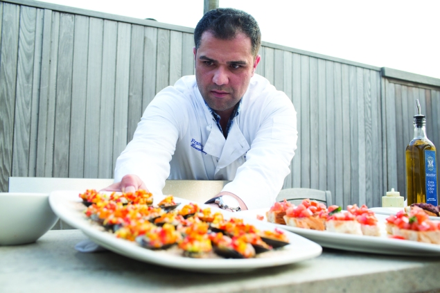 Chef Francesco Coli, who specialises in rooftop grilling parties, sets out some mussles in fresh vegetable mignon sauce - Aaron Adler for New York Observer