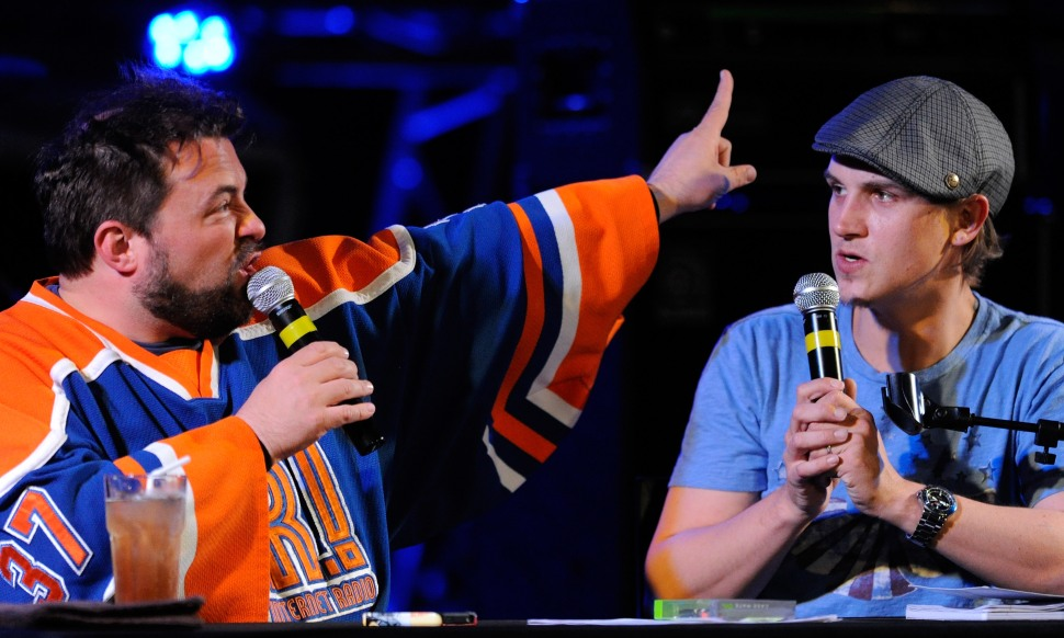 """LAS VEGAS, NV - NOVEMBER 04:  Writer/director Kevin Smith (L) and actor Jason Mewes perform their comedy podcast, """"Jay & Silent Bob Get Old"""" at the Hard Rock Cafe on the Strip November 4, 2011 in Las Vegas, Nevada."""