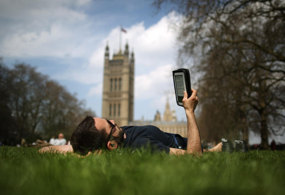 LONDON, ENGLAND - APRIL 25:  A man reads an ebook in Victoria Tower Gardens on April 25, 2013 in London, England. Following an unseasonably cold start to 2013, higher temperatures are being reported in southern parts of the United Kingdom.  (Photo by Peter Macdiarmid/Getty Images)