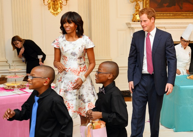 The First Lady and Prince Harry in May, 2013. (Photo: John Stillwell - WPA Pool/Getty Images)