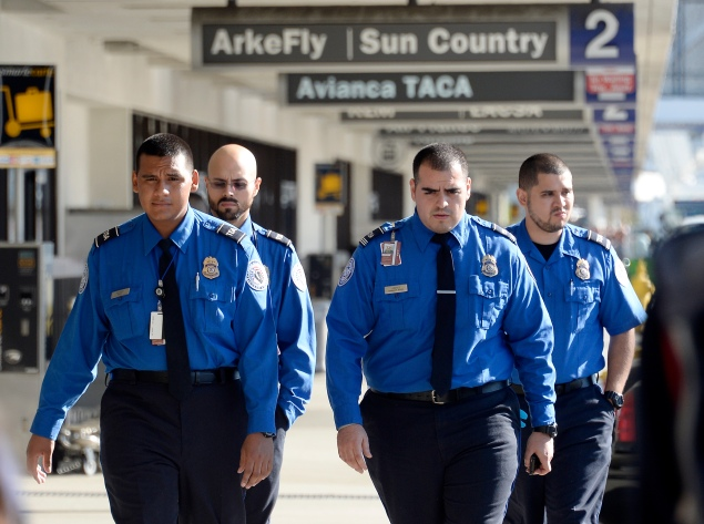 LOS ANGELES, CA - NOVEMBER 2: Transportation Security Administration agents walk on the departures level a day after a shooting that killed one Transportation Security Administration worker and injured several others at Los Angeles International Airport November 2, 2013 in Los Angeles, California. The airport is almost back to normal operations a day after a man pulled an assault rifle and shot his way through security at Terminal 3, killing one Transportation Security Administration worker and wounding several others. Federal officials identified the alleged gunman as Paul Ciancia, 23, of New Jersey. (Photo by Kevork Djansezian/Getty Images)