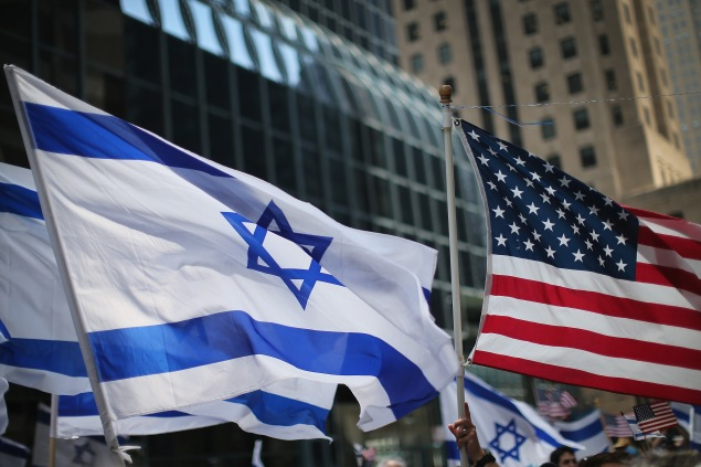 CHICAGO, IL - JULY 22: Pro-Israel demonstrators wave flags during a rally on July 22, 2014 in Chicago, Illinois. More than 1000 people supporting both sides of the 14-day-old conflict along the Gaza border attended separate rallies in the west Loop with a contingent of Chicago police in between making sure they remained separate. At least one person, a man draped in an Israeli flag, was taken into custody. (Photo by Scott Olson/Getty Images)